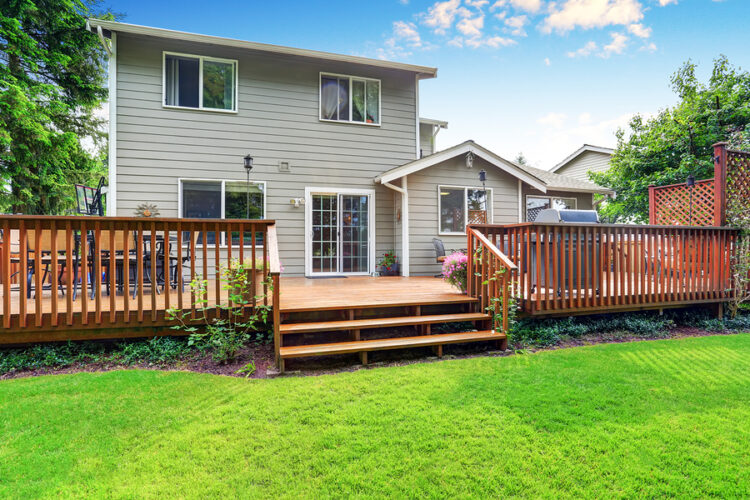 back yard house exterior with wooden deck